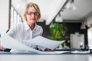 Businesswoman completing background check