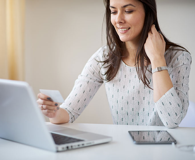 Woman completing background check online